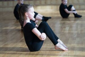 Group of children practising a gymnastics routine